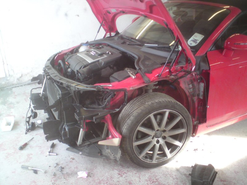 Audi TT, Off side front damage.  Front panel, bonnet and Near side front wing replaced.