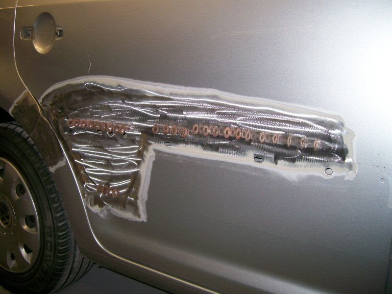Volkswagen Touran. Light accident damage to drivers side rear